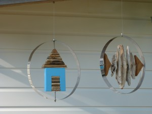 Wood Reincarnation Up cycled driftwood & stainless steel fish & beach hut garden hangers.